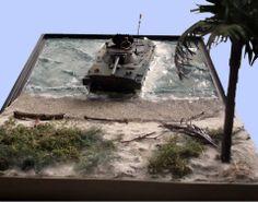 Military beach and tank model diorama.