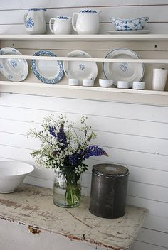 White shelf with blue and white dishes