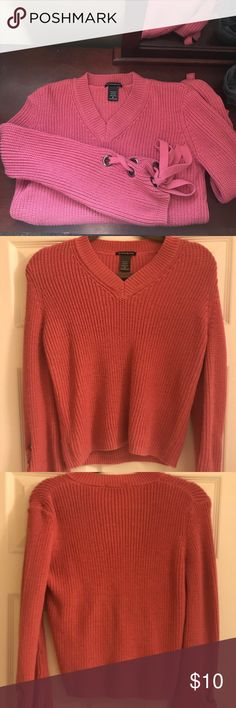 NWOT Pink knit sweater lace up sleeves A pink knitted sweater. V cut neck. NWOT and never worn! Sleeves tie up. Oversized fit Sweaters V-Necks