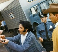 Elvis arriving in Houston, Texas. I'm surprised his autograph is still worth something, he signed it so many times