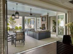 Patio Folding Doors. Patio Folding Doors open to covered patio with fireplace. #PatioFoldingDoors Megan Gorelick Interiors