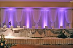 Lavender and Grey Wedding Backdrop, Purple LED uplighting, White voile with purple LED uplights, Wedding Decor, head table drapping,