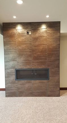 #WallTile #Wednesday features an AWESOME accent fireplace by @Brett Reid out of #Wyoming using our Alchemy Copper!  #WallTileWednesday #Alchemy #copper #fireplace #accent #decor #homedecor #interiordesign #design #thinking #DIY #build #designer #tile #flooring #floor #tiles #home #deco #porcelain #metallic #modern #look