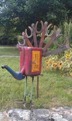 Horseshoe gas can peacock art
