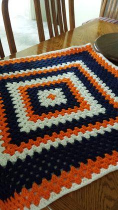 Broncos baby blanket that is fleeced lined