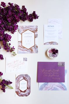 If you're thinking of being on trend and using shades of pretty purple in your wedding day palette, we are breaking down how to flawlessly design your invitation suites to set the tone!�
