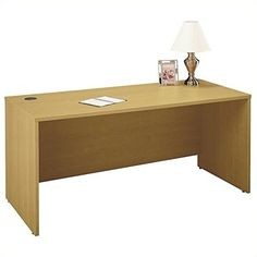 """Bush BBF Series C 66W Desk Shell in Light Oak. Durable thermally fused laminate work surfaces feature superior resistance to scratches and stains. All work Surfaces and leg end panels are 1"""" thick. Accepts Corner Module, Return Bridge or Credenza on right or left side. Accepts two 3/4 Pedestals, 2-Drawer or 3-Drawer Mobile Pedestals. Accepts Pencil Drawer or Keyboard Trays."""
