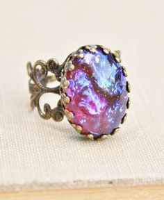 Hey, I found this really awesome Etsy listing at http://www.etsy.com/listing/157702346/vintage-dragons-breath-opal-ringmexican