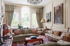 """The drawing room of [link url=""""http://www.houseandgarden.co.uk/interiors/real-homes/caroline-harrowby-georgian-town-house""""]the Ludlow house designed by Caroline Harrowby[/link] has a traditional English country feel. This is achieved through small touches such as the curtains which are in a [link url=""""http://www.colefax.com/""""]Colefax and Fowler[/link] fabric. The floral-print and embroidered cushions add colour and a welcome hint of the unexpected. [i]Taken from the May 2015 issue of House…"""