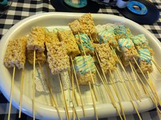 Rock star baby shower food! Rice Krispy treats dipped in chocolate with blue sprinkles