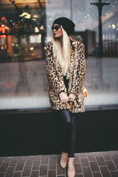 This combination of a brown leopard fur coat and black leather leggings is perfect for off-duty occasions. Tan leather pumps will add a touch of polish to an otherwise low-key look.  Shop this look for $122:  http://lookastic.com/women/looks/beanie-sunglasses-pumps-leggings-crossbody-bag-fur-coat/5503  — Black Beanie  — Black Sunglasses  — Tan Leather Pumps  — Black Leather Leggings  — Orange Leather Crossbody Bag  — Brown Leopard Fur Coat