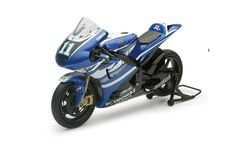 New-Ray Toys 1:12 Yamaha YZR-M1 Plastic Model Motorcycle 57423BS This Yamaha YZR-M1 Number 1 (Ben Spies - Moto GP 2011) Plastic Model Motorcycle is Blue and features working stand, steering, wheels. It is made by New-Ray Toys and is 1:12 scale (approx. 16cm / 6.3in long). Amazing amount of detail on this low cost model of Spies's 2011 season  bike. #New-RayToys #ModelMotorbike #Yamaha #MiniModelBikes