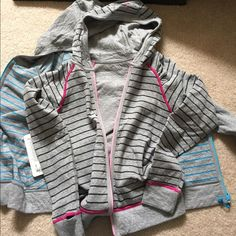 BNWT Ivivva Athletica Born to Dance hoodie size 14 Brand new with tags. Kids version of Lululemon size 14. Fits like a lulu 4 or 6. This is for the pink hoodie. lululemon athletica Jackets & Coats