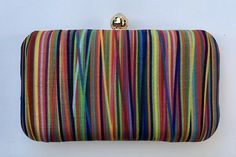 This multi-hued linear silk clutch can be paired with any look this summer – it can be that pop of color for an afternoon soiree look or just what your outfit needs for a touch of glam as you hit the town in the night. Chain: 48 in. Retro Fabric, Ramadan, Hue, Color Pop, Coin Purse, Pairs, Chain, Summer, Design