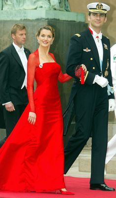 Princess Letizia wore an elegant red dress when the couple attended the wedding of Danish Crown Prince Frederik and Mary Donaldson in May 2004.