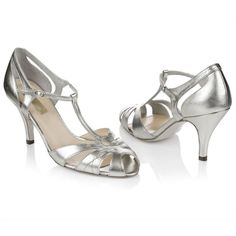 Metallic silver leather T-bar sandal with intricate cut out detail.