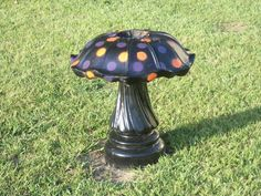 Re-purposed a retired bird bath (my hubby's idea)!    He turned the bird bath basin upside down, painted it, added spots and now we have a very large mushroom statue! Very cute!