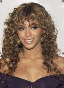 long naturally curly hairstyles with bangs
