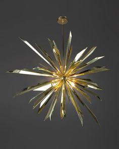 "Tony Duquette's ""California Sunburst 45"" chandelier. Wow, just...wow. #gold #chandelier #shiny"