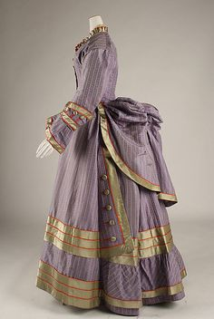Dress; ca. 1872 - 75; British; silk; fabulous brocaded silk, trimmed with gold silk, piped in red