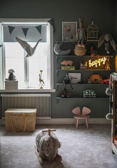 Here is proof that dark, moody kids rooms can be great.