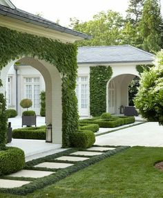 Well-manicured yard - beautiful architecture and landscaping