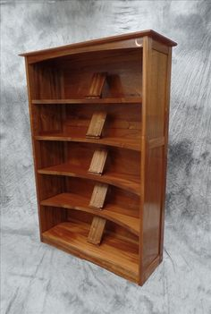Mahogany bookcase with moon inlay and book display stands