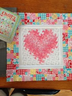 A Farm Wife's Journal. Scrappy 4-patch border from Quilty Fun.