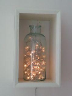 A string of Christmas lights in a glass jar brings light to a shady spot