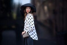 Red lips, small crossbody bag, floppy hat, polka dot blouse