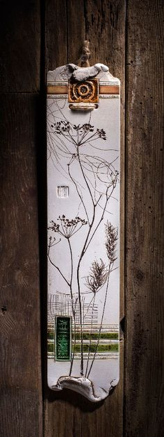 Botanical pieces have been pressed into the wet clay to create the elegant look of those wall plaques.Varied textures and vibrant colors make them an exquisite piece of the home decor.: