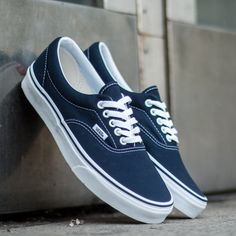 Vans Era Navy Canvas Sneaker Classic Vans Era canvas sneaker in navy. Excellent summer shoe that is both comfortable and versatile. Men size 7.5, Woman size 9. Vans Shoes Sneakers