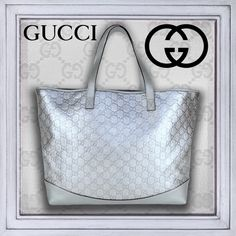 4XHPGUCCI Guccissima Embsd Silver Leather Tote Gucci's Iconic logo a highly desired symbol of Italian luxury. Authentic Signature embossed (Guccissima) Silver metallic leather, smooth grain trim. 2 leather shoulder straps; (open top). Brown easy-care textile lined interior, back wall zip pocket. Made in Italy. A highly coveted classic for years to come.   This roomy tote is suited as a shopper, a business tote or for a weekend getaway. Includes Dust cover, controllato card & Product info…