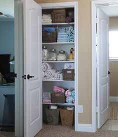 A shelf for each bedroom keeps bedding organized and lets kids help themselves to extra towels. Dedicate a middle shelf to spare toiletries the whole family uses.