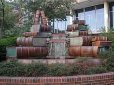 "Book fountain at the Main Library in Cincinnati, OH, USA. ""The Amelia Valerio Weinberg Memorial Fountain, on the Vine Street Plaza, was conceived and executed by former Cincinnati sculptor Michael Frasca. The ""book fountain"" features water cascading over a stack of ceramic tile books, representing the free flow of information and ideas through the printed word."""