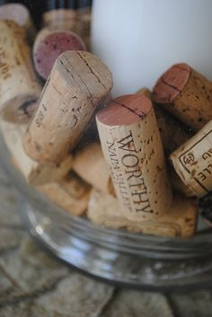 Wine corks in hurricane glasses with candle