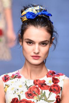 As ever, the beauty at Dolce&Gabbana was an elegant affair. The makeup look was about luminous skin, soft feline eyes and plump lips, which showcased the full range of new Dolce Matte Rosa Lipsticks. The messy updos were adorned with headscarves, headbands or opulent crows. Stunning.
