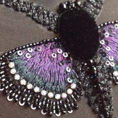 ...А бабочка крылышками....