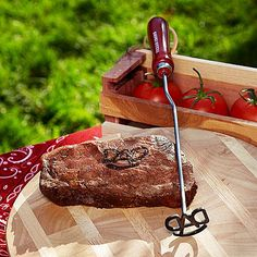 """An unforgettable gift for your grilling enthusiast or outdoor cook! Crafted of durable stainless steel with a wood handle, our handsome branding iron is easily heated on an open flame or charcoal grill. Just heat it up and brand those steaks and meats with pride. We personalize the head of the brand with """"DAD"""" or any 3 initials (please specify order of initials). Comes beautifully wrapped in an authentic Western bandana and presented in a gorgeous cedar gift box. Iron measures 14""""L. Hand…"""