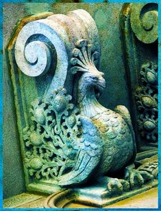Peacock corbel on a building...