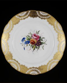 Nantgarw China Works, Wales - Porcelain plate painted with flower spray and gilt fan design on border - ca. 1814