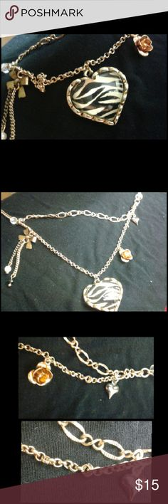 Zebra pendant Betsey Johnson necklace Heart pendant worth a zebra print. Simulated double chain with hanging charms. Worn a few times bit in great condition. In prefect working condition. Authentic Betsey Johnson. Betsey Johnson Jewelry Necklaces