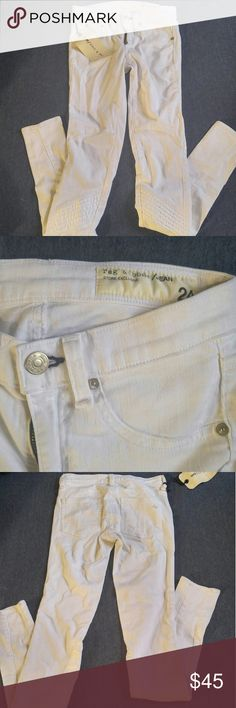Rag and bone size 24 moto white jeans/leggings New with tags but with defects. These jeans are amazing! The material is really soft and there is chic moto detail on the front. There is small black spots o of the jeans from being handled in the store and possible die transfer. I didn't try washing them but it may come off. It isn't noticeable from far away (3rd pic) rag & bone Jeans Skinny