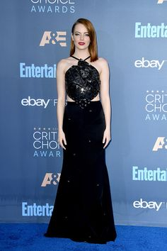 Actress Emma Stone in Roland Mouret with Cartier jewels attends The 22nd Annual Critics' Choice Awards at Barker Hangar on December 11 2016 in Santa Monica California