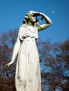 Woodlawn Cemetery Bronx, NY.  I have never seen a status shading its eyes. Very different to see.