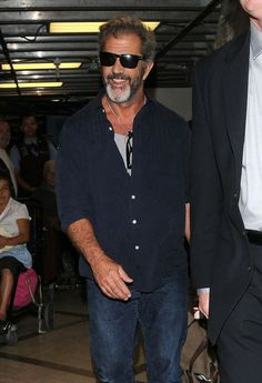 Mel Gibson - Mel Gibson Arriving On A Flight At LAX