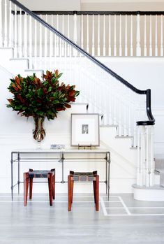 """When space is limited, it's easy to treat your entryway like a mudroom, but Mazzarini says this is a mistake. """"Your entry should feel welcoming, and clean. I love signs of life (keys, books, a..."""