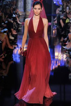 Elie Saab Fall 2014: This is a red ombre halter gown. The silhouette of the gown is simple but the ombre effect is what makes it unique!