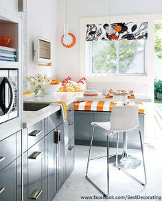 Great complimentary color combo blue / grey with a bold orange tone