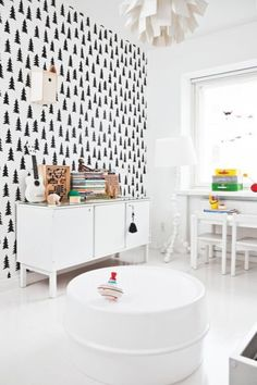 Geometric black and white kids playroom with colorful toys